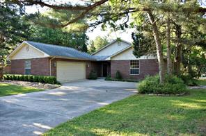 Motivated Seller! Stunning home in New Ulm in the gated community of The Falls is move in ready!  The 3 bd/2 ba custom home has beautiful views overlooking the 15th hole.  Enjoy this lovely view off the spacious deck shaded by huge oak trees.  Custom drapes and blinds are wonderful.  Other features: huge den w/a great wood burning fireplace, breakfast area as well as dining area or additional seating space, wet bar area, alarm system, water softener system, all appliances convey.