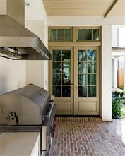 Sample finishes of the builders outdoor kitchen. French doors lead you to your brick paved generous porch, with built-in outdoor grill is perfect for outdoor grilling and entertaining.