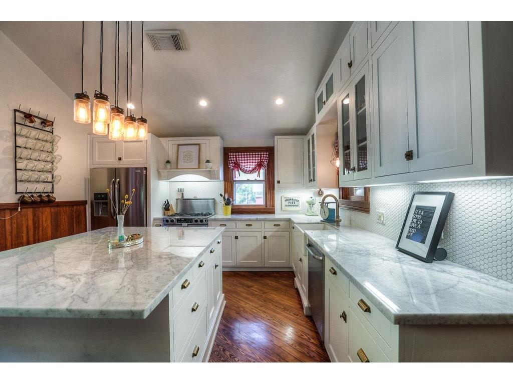 Updated kitchen features a breakfast bar in the center island which makes a great space for the family to congregate.