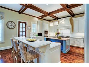 Double island kitchen with breakfast serving bar.  Each island has a sink and dishwasher.