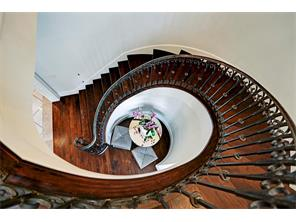 Wrought iron curved stairway.