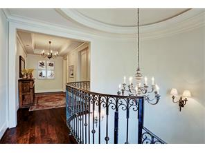 Second floor stairway landing with rotunda dome ceiling.  Double doors off the gallery open to the gameroom.