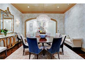 Dining room with custom glazed paint and marbleized wallpaper.