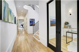 Sweeping entryway is a perfect location to feature artwork and offers privacy from the common areas.