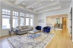 Large second floor game room or additional media space with dedicated storage closet.
