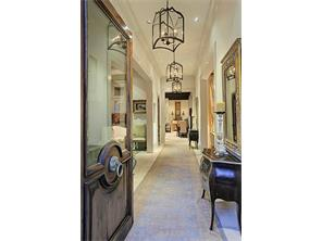 Foyer - impressive front door opens to 27  x 6   gallery.  Exquisite entry door with brass hardware and beveled glass. Upon entering, the dining room is to the left,  living room to the right, and the kitchen and family room at the end of the hall.