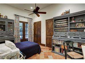 Versatile downstairs space could be used as guest room, craft room or quarters.  French doors with view of garden.