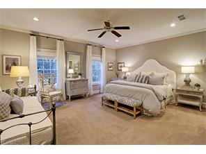 Additional bedroom suite with windows employing treetop views.  Crown molding, custom drapes and black out shades plus enormous walk-in closet.