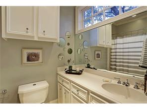 Ensuite bath with tub/shower with tile surround.  Note Clerestory windows that allow abundant natural light.