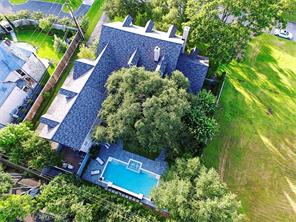 Aerial view of 5539 Cranbrook Road.  Located within minutes to Tanglewood Boulevards walking path that is tree lined with live oaks and serves as a gathering place for residents.  It also included various benches, walking trails & bike path.