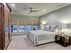 Oversized 21  x 14  Secondary Bedroom offers custom Roman shades, designer low pile carpeting, massive walk-in closet with built-ins and an impeccable view of the backyard paradise.