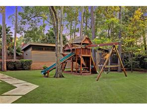Whimsical play scape and generously sized storage buildings appeal to all generations! Equipped with custom shelving, these two storage buildings are the perfect place to house yard equipment as well as any DIY projects you may be working on!