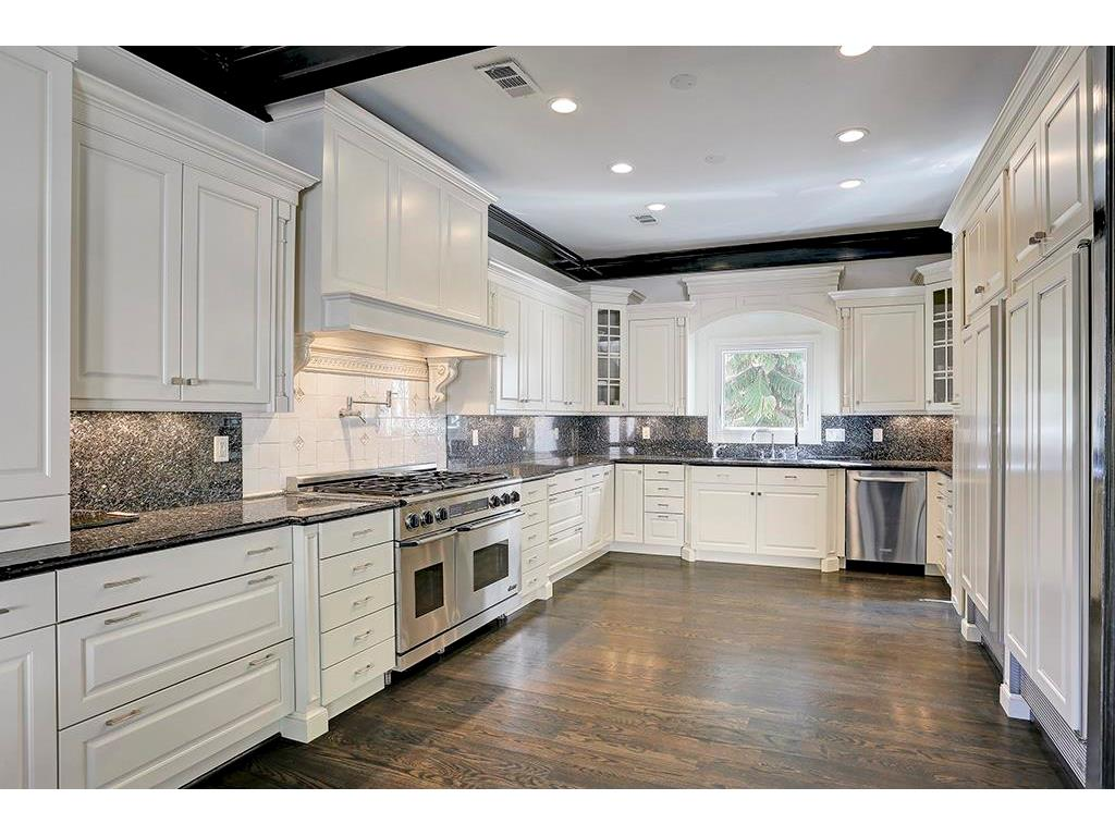 Wide open kitchen is a chef s wonderland! Twin Sub-Zeros and gas range with double oven