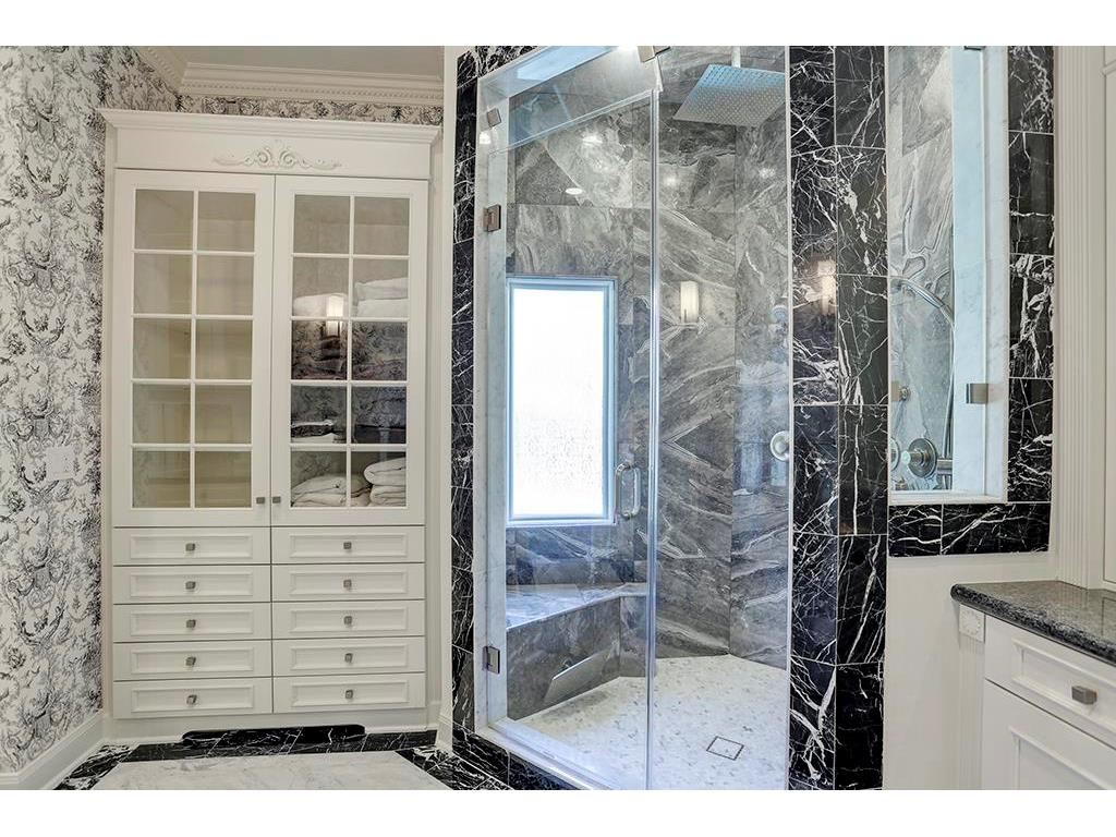 Silver Fantasy marble steam shower is the focus of the bath