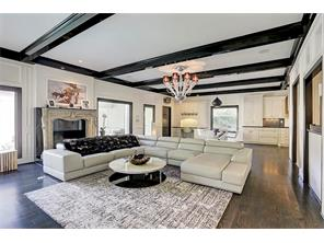 Beamed ceiling, antique fireplace surround and wet bar round out the family room