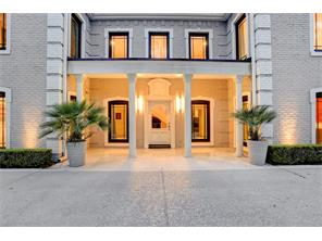 Crisp LED lighting and a sleek marble entrance set the stage  for this grand renovation