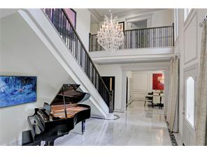 Spectacular two-story entry with decadent crystal chandelier and marble flooring...WOW!