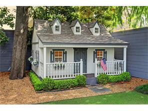 Endearing storybook playhouse.     Architectural detail abounds with window boxes, shutters, front porch, dormer windows and yes, its own boxwood landscaping.  Simply perfect!