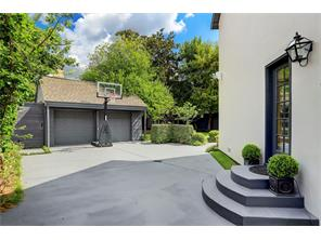 Great size driveway and parking court.  Perfect for a basketball game!  The door is the entrance to the family room.