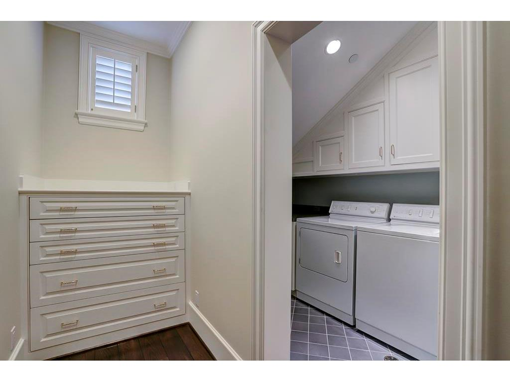 The 2nd Floor LAUNDRY ROOM has a sink, a built-in ironing board, a tile floor and ample folding space.  Notice the built-in dresser outside of the Laundry Room - perfect for storing wrapping paper.