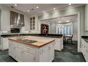 The CHEF S ISLAND KITCHEN is open to the Breakfast Room and has a window opening to the Family Room (to the right).  Notice the recessed lighting and the brass hardware & hinges.
