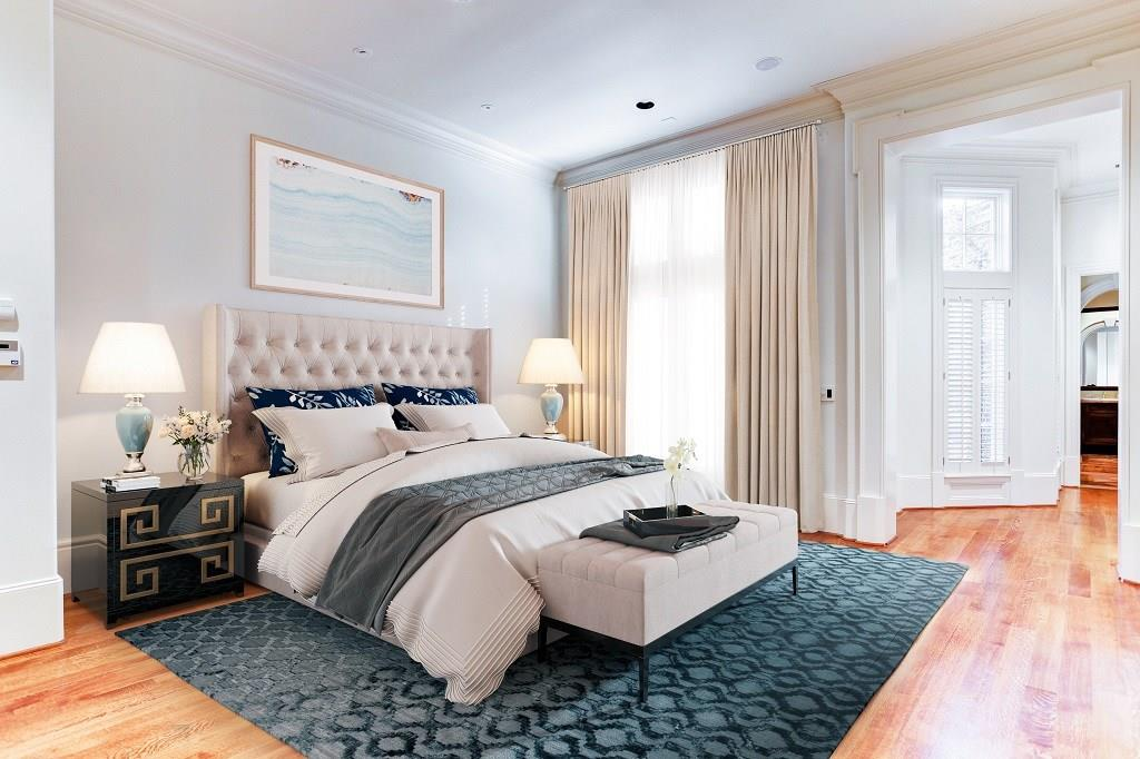 Another view of the Master Bedroom with its mullioned windows providing a view of the backyard gardens and the  cased entries to the Sitting Room and En Suite Baths.