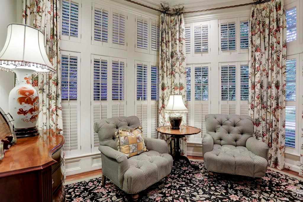 The MASTER SITTING ROOM (14X8) provides a restful spot to enjoy a quiet moment!  It features a built-in storage/TV cabinet, hardwood flooring, crown/base molding, plantation shuttered windows (designer drapes), recessed lighting.
