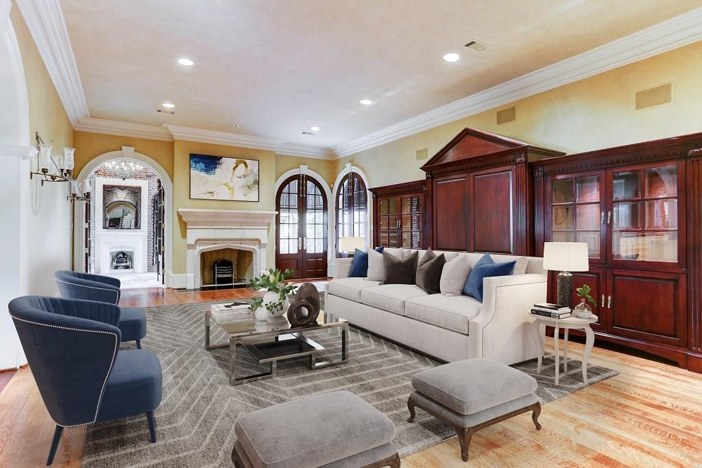 Downstairs HALLWAY to the Living and Dining areas is beautifully designed with a painted barrel vaulted ceiling, cove lighting, handsome painted wainscoting/ wood trim and stained wood flooring with decorative insets.