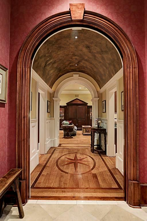 Just beside the Kitchen is the BREAKFAST ROOM (18X10) with its shuttered windows (designer drapes) papered walls, painted tin ceiling, stone tile flooring, recessed lighting, stained wood crown/base molding.