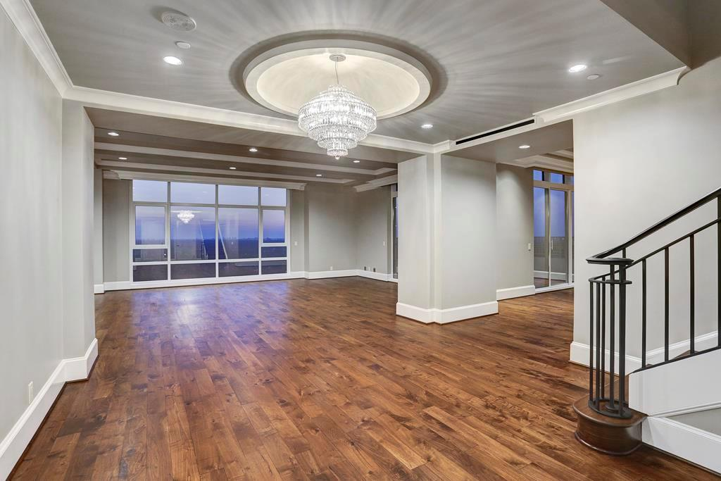 As you enter the large &gracious entry you will notice the wide open spaces and over-sized rooms that make grand scale entertaining a breeze. Floor to ceiling windows wrap the entire property, some with electric shades. Hardwood floors up and down.