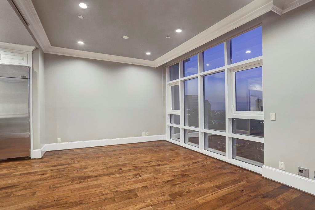 This picture shows you the breakfast room opens to the family room. The kitchen is open to the breakfast room.  This property is in move-in condition.