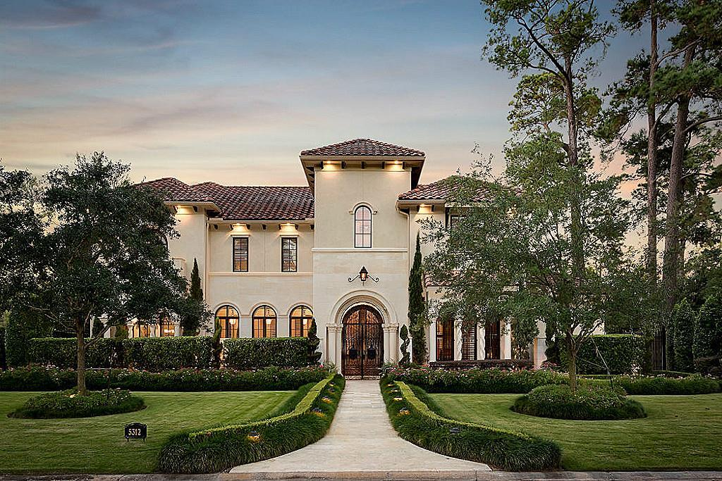 Exceptional architectural integrity and the finest finishes distinguish this Palladian-style home in Pine Shadows.