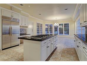 The chef s kitchen has wonderful counter space and island cook top, large stainless steel fridge and a dedicated breakfast room that overlooks the back yard resort like pool.