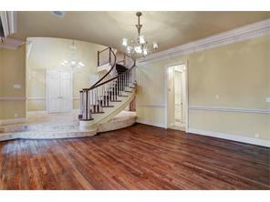 Formal dining room has hardwood floors and is spacious and bright and can accommodate a large dining room table.