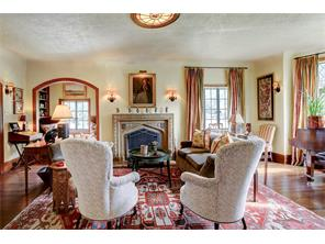 Elegant formal living, spacious for entertaining, leaded glass paneled windows, lots of natural light.