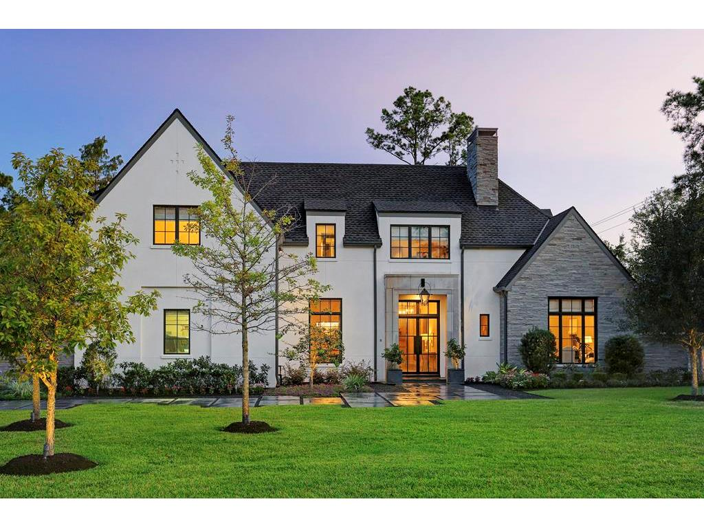 2 GREYTON LANE, built by Abercrombie Builders, has an Acadian French design and looks & feels like a new home.  Its facade is stucco and stone, and the stone is extended in privacy walls on both sides of this incredible home.