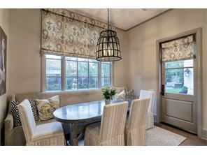 The BREAKFAST ROOM has  substantial divided light windows for beautiful views of the backyard & pool, and is large enough for a family to have breakfast together!  Notice the charming cage chandelier and the door w/windows leading to the back porch.