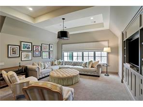 On the 2ND FLOOR, there is a spacious GAME ROOM with built-in cabinets and its own WET BAR.