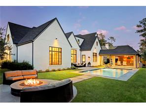 The BACKYARD that has it all - a  HEATED POOL by Sunshine Pools with a Pebbletech surround, a built-in gas FIRE PIT and the large OUTDOOR LOGGIA & SUMMER KITCHEN.  There is also plenty of room for playing with kids and pets.