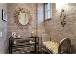 The POWDER BATH is conveniently located off the Foyer and is close to the Family Room and Formal Dining Room.