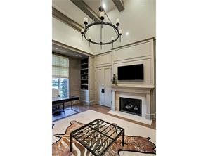 The STUDY has a vaulted, beamed ceiling, a gas-log fireplace and is tucked away off of the Foyer.  This lovely room has hardwood floors, beautiful built-ins and plenty of storage.
