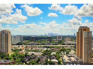 "This unit features east, south and west facing views. This view of downtown Houston skyline is phenomenal from this   villa in the sky""."
