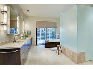 The Master Bathroom features a hydrotherapy tub, a large walk-in shower that can be accessed from opposite sides, double sinks and two water closets.