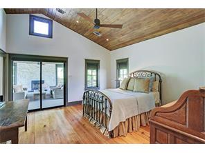 Bedroom #2, with vaulted wood panel ceilings, recessed light and a ceiling fan, has access to the fantastic outdoor covered deck --