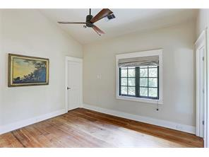 """The Fourth Bedroom has beautiful 11"""" reclaimed pine floors, casement windows with custom Roman shades and a walk-in closet"""