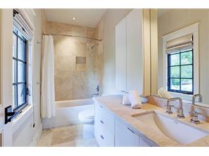 The fourth bedroom also has an elegant en-suite bathroom.