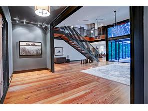 The Foyer, with its a neutral gray tones and track lighting, is a wonderful place to display art.