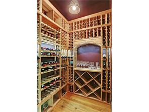The elevator shaft has been converted into a custom temperature-controlled Wine Room.