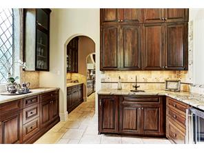 Wet bar with rain forest granite perfectly positioned for entertaining.  Butler s pantry that adjoins has arched window of leaded glass and beautiful tile work.