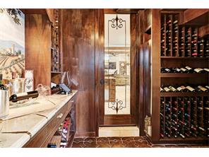 Beautiful temperature controlled wine room that can accommodate 300 bottles of wine. Exquisitely appointed with Segreto mural and stenciling.